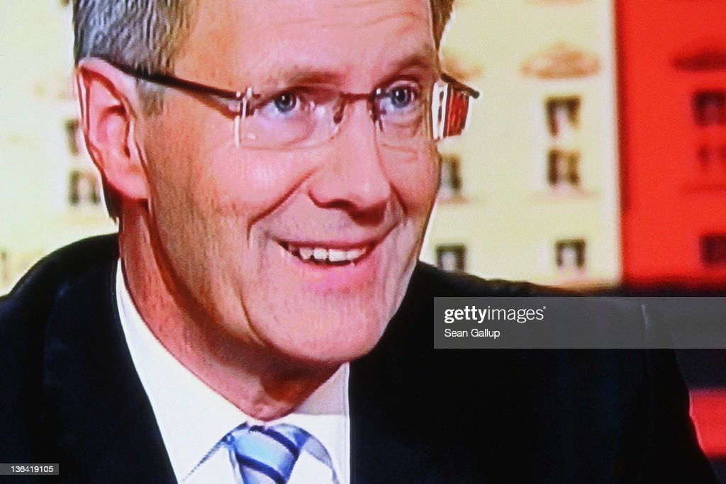 In this photograph of a television screen German President <a gi-track='captionPersonalityLinkClicked' href=/galleries/search?phrase=Christian+Wulff&family=editorial&specificpeople=221618 ng-click='$event.stopPropagation()'>Christian Wulff</a> responds to critics in a television interview on January 4, 2011 in Berlin, Germany. Wulff has come under increasing pressure to resign following reports that he personally intervened in attempts to prevent journalists from writing about aspects of his personal life, including a recent call to Editor-in-Chief Kai Diekmann of Bild Zeitung, in which he threatened Diekmann with legal action should the paper publish a story about Wulff's personal finance conduct while Wulff was prime minister of Lower Saxony. These accusations come on the heels of revelations of cozy relationships between Wulff and businessmen in Lower Saxony that included free holidays and low interest loans.