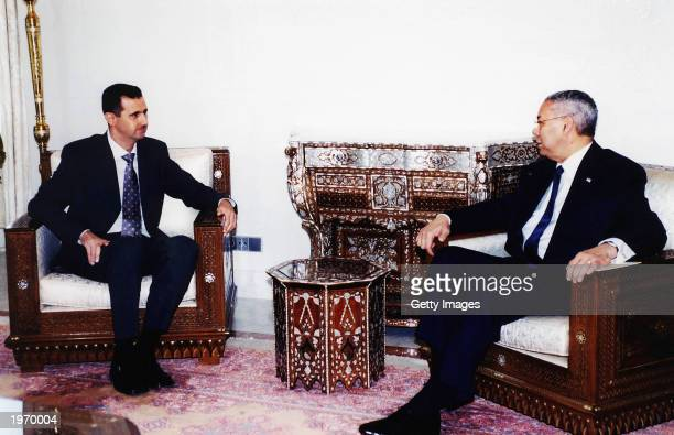 In this photograph provided by the Syrian news agency SANA Syrian President Bashar alAssad talks with US Secretary of State Colin Powell May 3 2003...