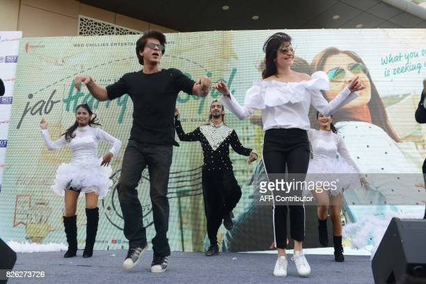 In this photograph taken Agust 3 2017 Indian Bollywood actors Shaharukh Khan and Anushka Sharma dance during a promotional event for their upcoming...