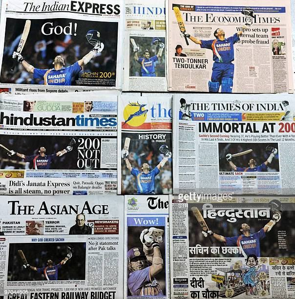 In this photograph taken in New Delhi of combined Indian national newspaper frontpages on February 25 Indian cricketer Sachin Tendulkar is shown...