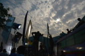 In this photograph taken January 21 Indian film crew are seen silhoutted against the evening sky during a shoot at an outdoor studio set during a...
