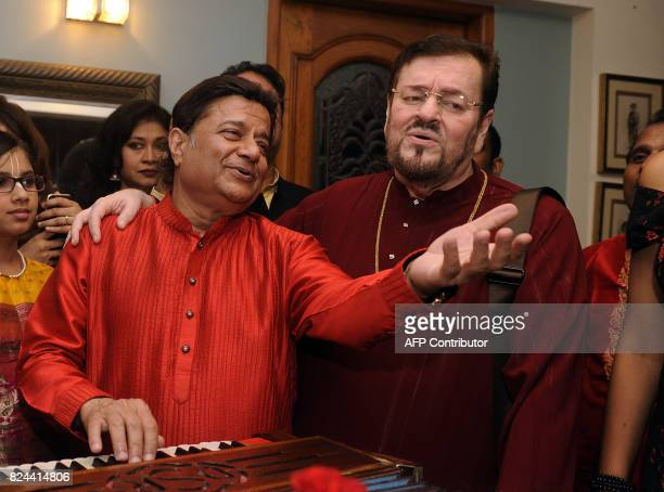 In this photograph taken July 29 2017 Indian singer Nitin Mukesh performs during the 64th birthday celebration of Ghazal and Bhajan singer Anup...