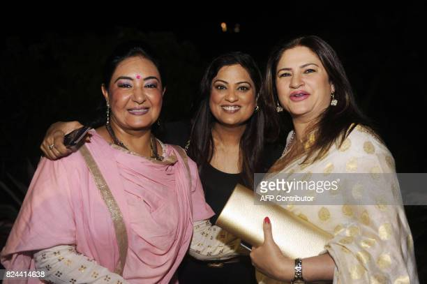 In this photograph taken July 29 2017 Indian singers Jaspinder Narula Richa Sharma and actress Kunickaa Lall pose for a picture during the 64th...