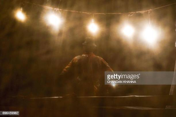 TOPSHOT In this photograph taken June 15 an Indian artist perform during a 'Ramleela' play in Jaitaran some 80 kms north of Jodhpur in the northern...