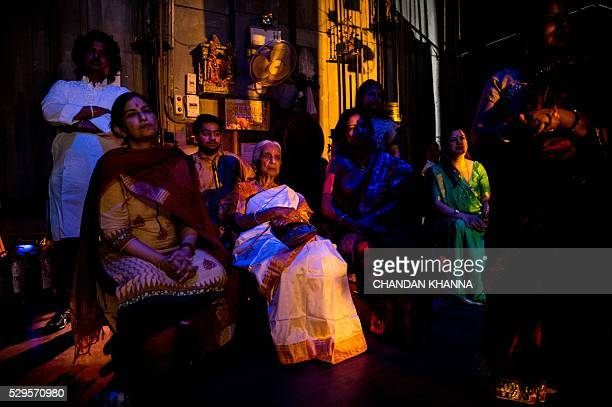 In this photograph taken late May 8 Indian musician Girija Devi sits backstage as she waits to take part in a performance marking her 87th birthday...