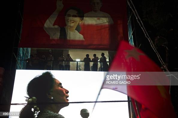 In this photograph taken late on November 9 a huge portrait of Myanmar opposition leader Aung San Suu Kyi is displayed on the facade of the National...