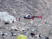 In this photograph taken on April 18 a Nepalese rescure helicopeter lands at Everest Base Camp during rescue efforts following an avalanche that...
