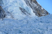 In this photograph taken on April 18 survivors work to dig free and assist the injured following an avalanche that killed sixteen Nepalese sherpas in...