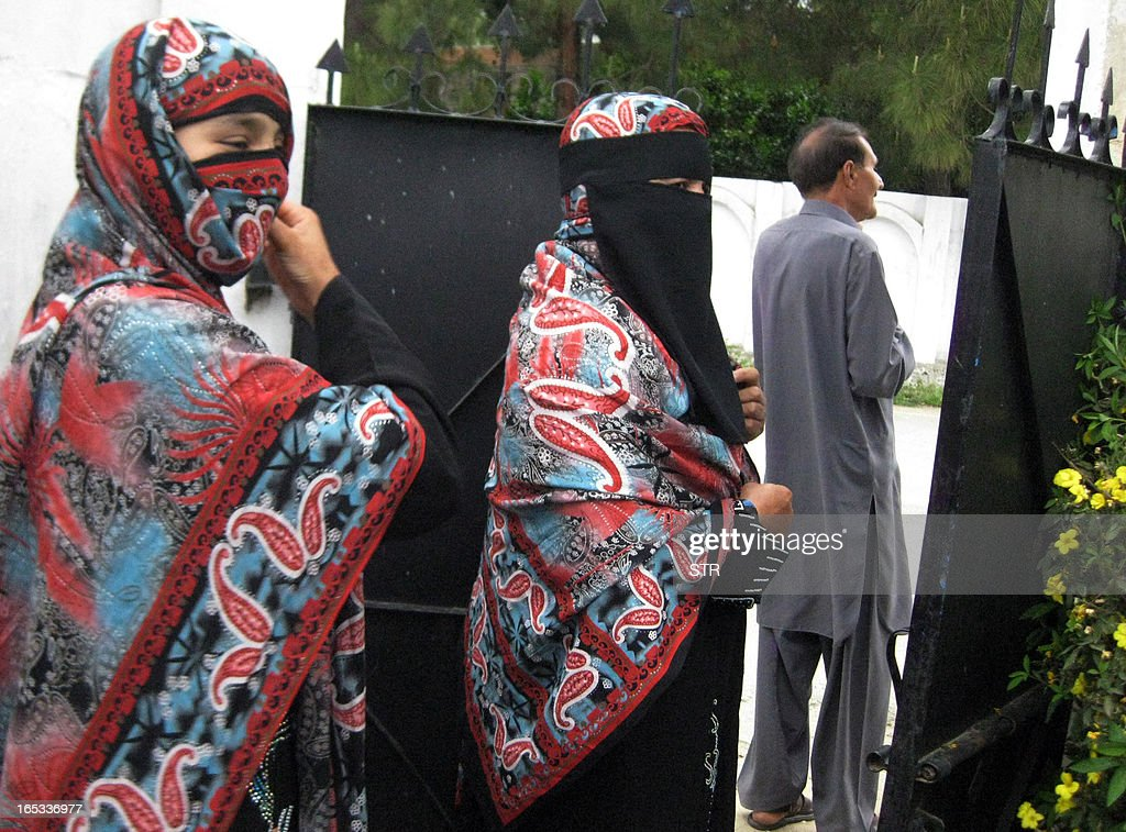 In this photograph taken on April 2, 2013, Pakistani Badam Zari (C), 55, a candidate for upcoming general elections,walks through a gate while campaigning in Khar, the main town of Bajaur, one of seven districts in country's semi-autonomous tribal belt, where Taliban and Al-Qaeda-linked militants have carved out strongholds used to plot attacks on Pakistan. Zari, in a rare move decided to try her fate in the country's May 11 general elections. In Pakistan's 60 years of history, no female candidate from a tribal region has ever contested or won an election.