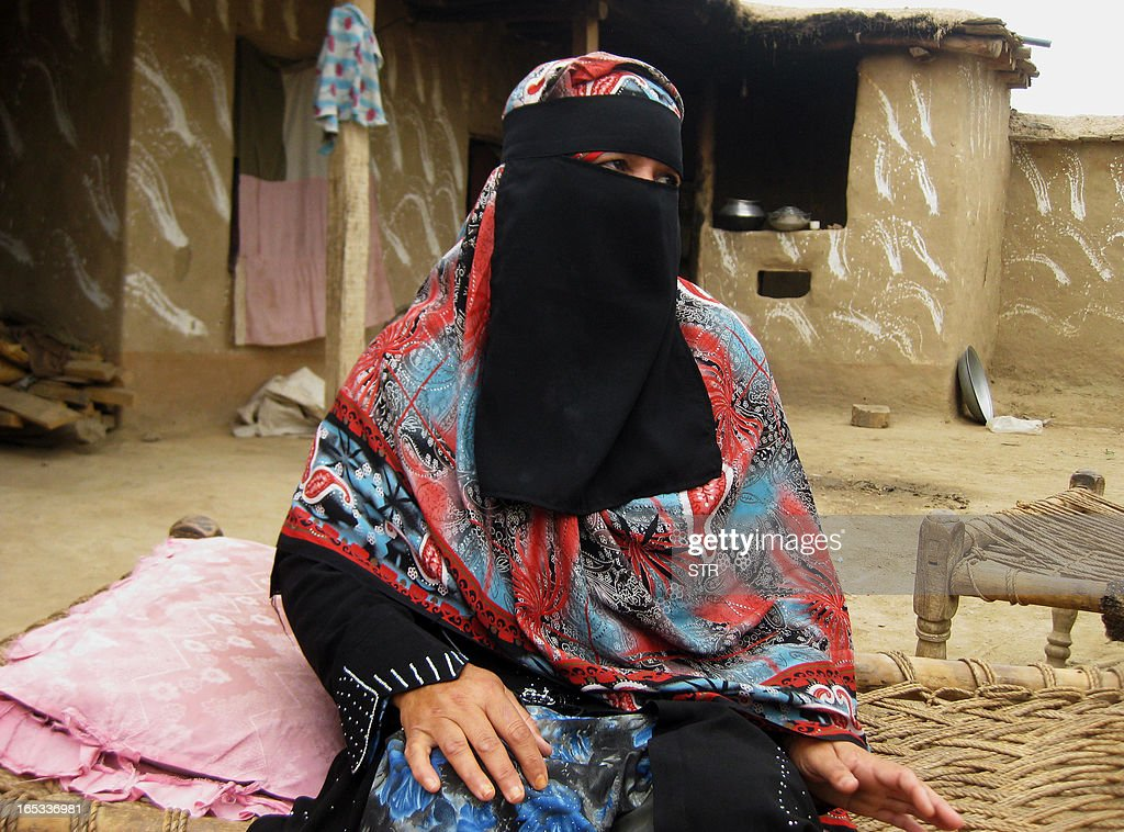 In this photograph taken on April 2, 2013, Pakistani Badam Zari, 55, a candidate for upcoming general elections looks on while speaking to potential voters during her campaign in Khar, the main town of Bajaur, one of seven districts in country's semi-autonomous tribal belt, where Taliban and Al-Qaeda-linked militants have carved out strongholds used to plot attacks on Pakistan. Zari, in a rare move decided to try her fate in the country's May 11 general elections. In Pakistan's 60 years of history, no female candidate from a tribal region has ever contested or won an election.