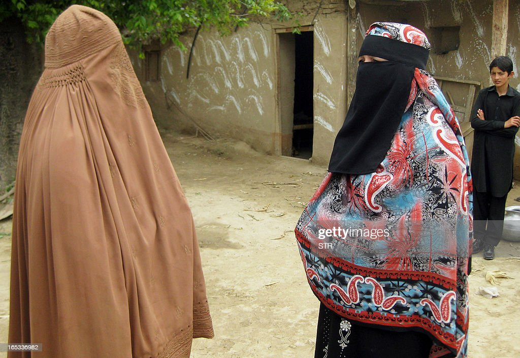 In this photograph taken on April 2, 2013, Pakistani Badam Zari (R), 55, a candidate for upcoming general elections, speaks with a woman during her campaign in Khar, the main town of Bajaur, one of seven districts in country's semi-autonomous tribal belt, where Taliban and Al-Qaeda-linked militants have carved out strongholds used to plot attacks on Pakistan. Zari, in a rare move decided to try her fate in the country's May 11 general elections. In Pakistan's 60 years of history, no female candidate from a tribal region has ever contested or won an election.
