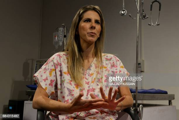 In this photograph taken on April 24 vet trainer Dr Fernanda Scarpa Rodrigues speaks during an interview with AFP at the Renalvet clinic for animals...