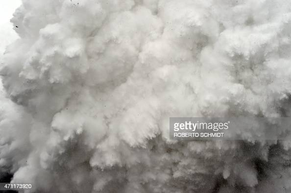 In this photograph taken on April 25 a cloud of snow and debris triggered by an earthquake flies towards Everest Base Camp moments ahead of...
