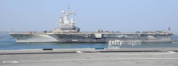 In this photograph taken on April 25 France's aircraft carrier Charles de Gaulle is seen from INS Viraat as it lies off the Indian coast at Goa ahead...