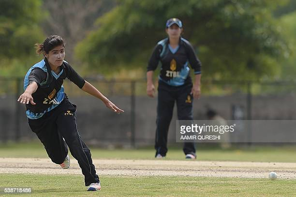In this photograph taken on April 25 Pakistani national cricket and football player Diana Baig runs to field the ball during a domestic cricket...
