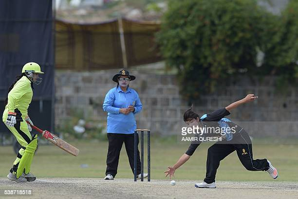 In this photograph taken on April 25 Pakistani national cricket and football player Diana Baig fields the ball during a domestic cricket championship...