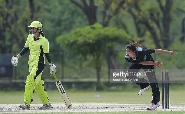 In this photograph taken on April 25 Pakistani national cricket and football player Diana Baig delivers the ball during a domestic cricket...