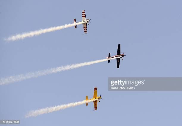 In this photograph taken on April 27 aircraft from the British aerobatics display team 'Global Stars' participate in a rehearsal ahead of an airshow...