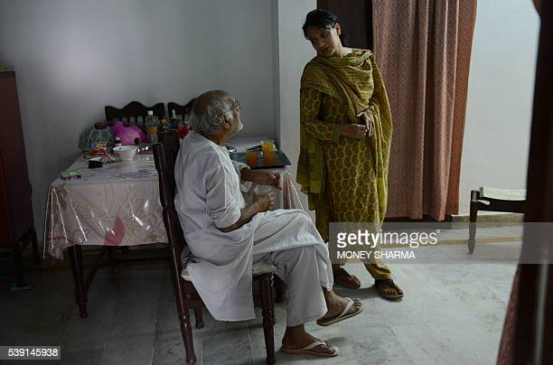 In this photograph taken on April 28 2016 Sadaf Mehmood talks with her father at her house in Bhopal Only three words were scrawled on the letter...