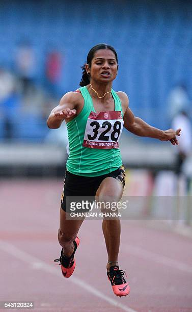 In this photograph taken on April 28 Indian sprinter Dutee Chand takes part in the women's 100 metres during the 20th Federation Cup National Senior...
