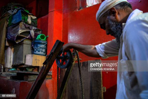 In this photograph taken on April 28 Indian water carrier Shakeel Ahmad draws water from a well inside a Sufi shrine in New Delhi Shakeel Ahmad...