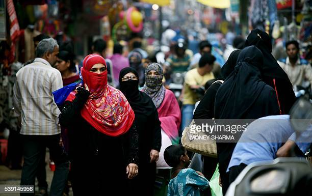 In this photograph taken on April 28 Muslim shoppers walk through a market in Bhopal Only three words were scrawled on the letter from her husband...