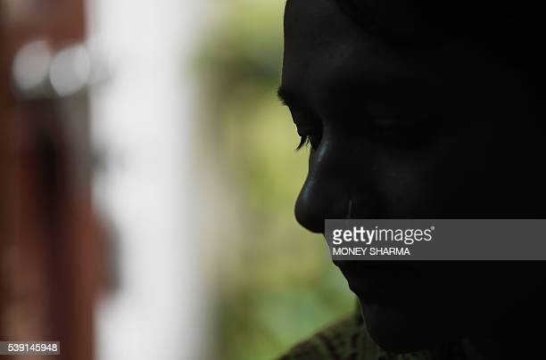In this photograph taken on April 28 Sadaf Mehmood talks during an interview with AFP at her house in Bhopal Only three words were scrawled on the...