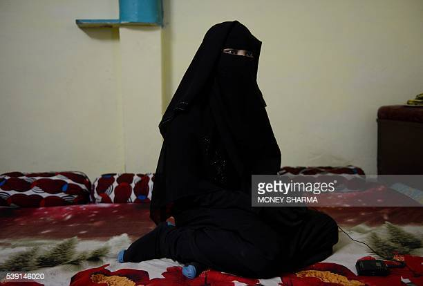In this photograph taken on April 28 Shaista Ali looks on during an interview with AFP at her house in Bhopal Only three words were scrawled on the...