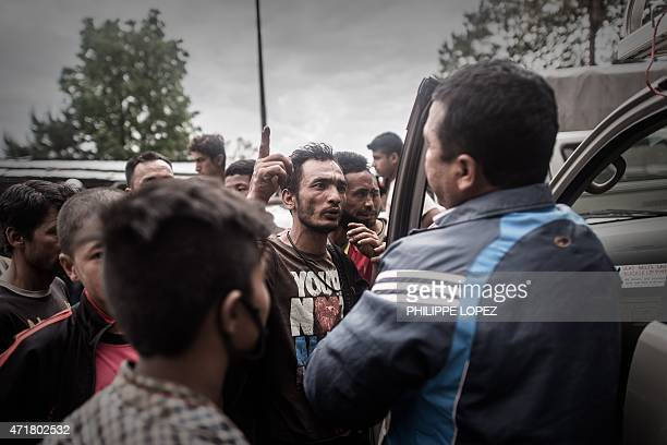 In this photograph taken on April 30 angry Nepalese earthquake survivors argue with an aid worker after stopping his car to ask for food on the...