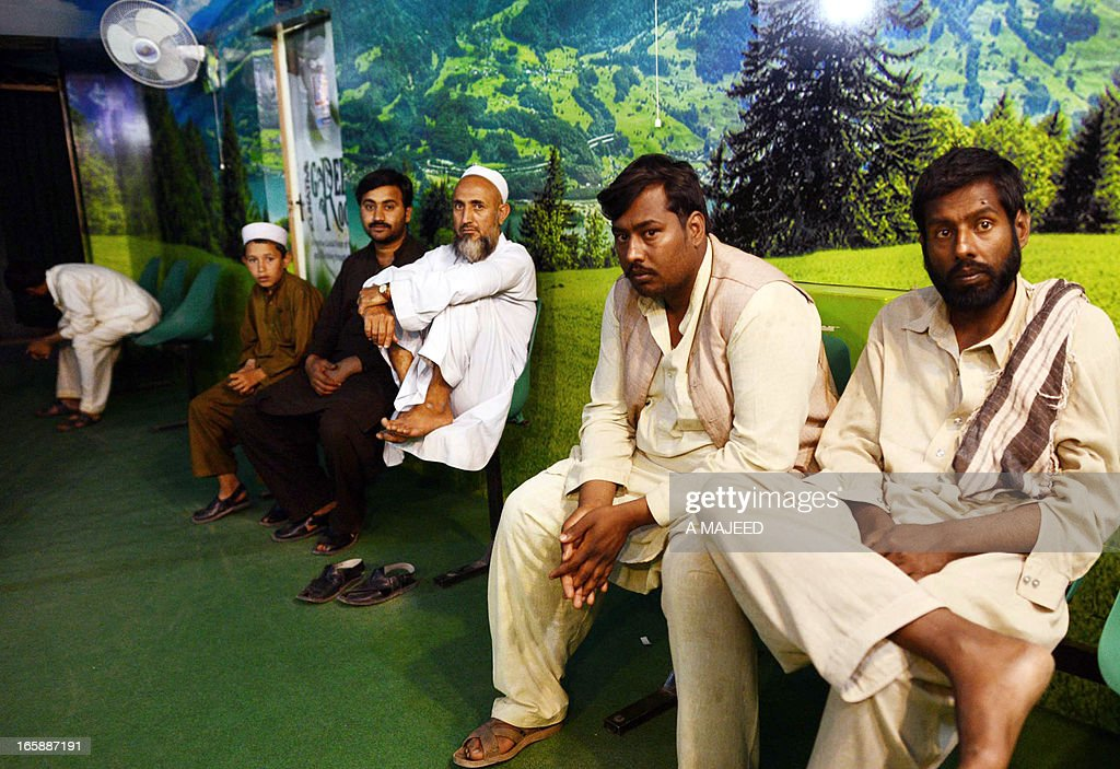 In this photograph taken on April, 5 2013, Pakistani patients wait to see psychiatrist Mian Iftikhar Hussain at his private clinic in Peshawar. After nine friends and relatives were killed in a US drone strike four years ago, Mohammed Fahim took tranquilisers to blot out the nightmares, one of a growing number of Pakistanis suffering from conditions related to depression, anxiety and mental health problems because of war. AFP PHOTO/ A MAJEED