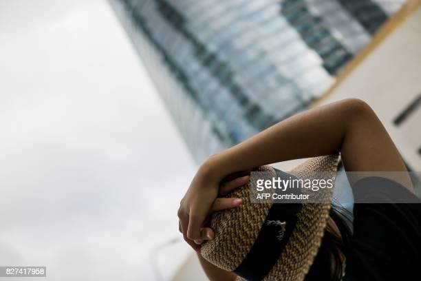 In this photograph taken on August 1 a Chinese woman gestures in the Lujiazui Financial District in Pudong in Shanghai A wildly popular drama likened...
