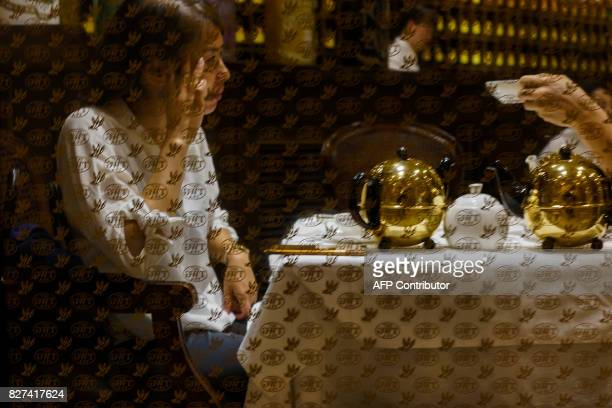 In this photograph taken on August 1 Chinese women drink tea at the Lujiazui Financial District in Pudong in Shanghai A wildly popular drama likened...