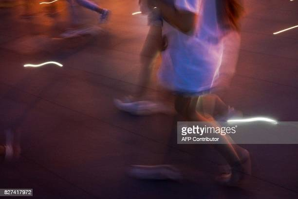 In this photograph taken on August 1 Chinese women walk on the Bund along the Huangpu River at the Bund in Shanghai A wildly popular drama likened to...