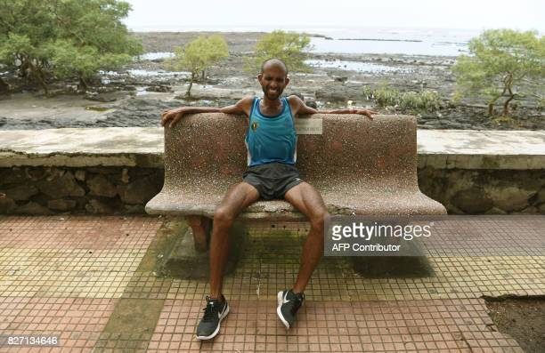In this photograph taken on August 1 Indian runner Samir Singh rests after his morning run in Mumbai Tormented by blisters illness and injuries...