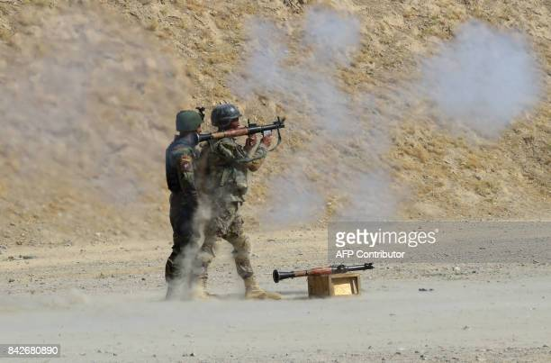 In this photograph taken on August 10 Afghan commandos fire a RPG7 rocket launchers during live firing exercises at Camp Morehead on the outskirts of...
