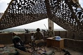 DECAMME In this photograph taken on August 12 US army personnel keep watch at coalition force Forward Operating Base Connelly in the Khogyani...