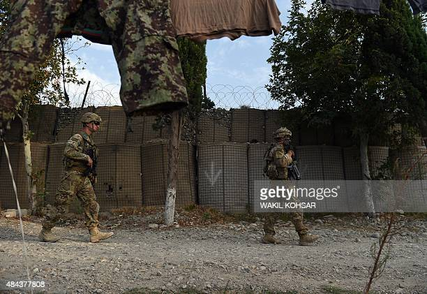 DECAMME In this photograph taken on August 12 US army soldiers walk past an Afghan National Army base in the Khogyani district in the eastern...