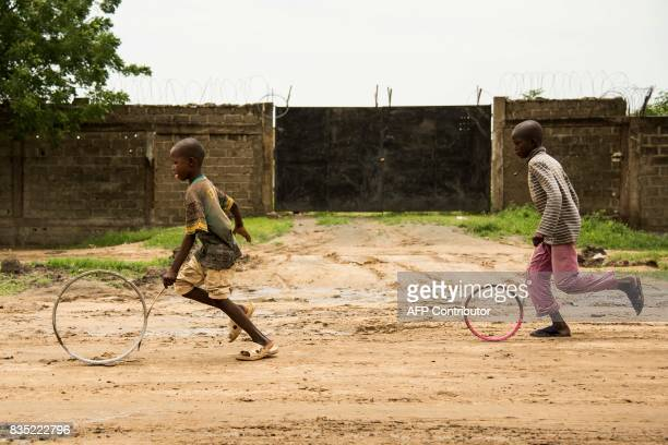 In this photograph taken on August 15 children play in a street in the southern district of the Chadian capital of N'Djamena / AFP PHOTO / Xaume...