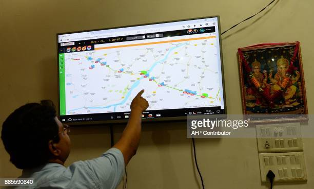 In this photograph taken on August 17 an Indian official works at Bihar government's excise department control room in Patna where they monitor the...
