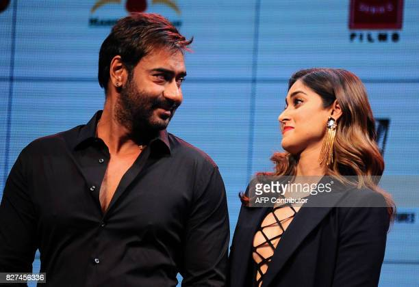 In this photograph taken on August 2017 Indian Bollywood actors Ajay Devgn and Ileana D'Cruz look on during the trailer launch of the upcoming Indian...