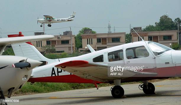 In this photograph taken on August 6 a small Cessna plane lands at Pakistan's Walton airport in Lahore where youngsters take flying classes to adopt...