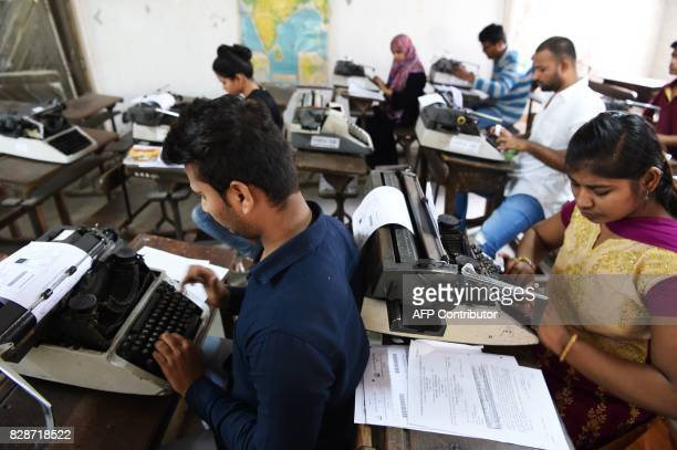 In this photograph taken on August 7 candidates appear for the last official typing exam conducted by the state government in Mumbai The unmistakable...