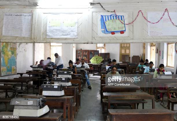 In this photograph taken on August 7 candidates take part in the last official typing exam conducted by the state government in Mumbai The...