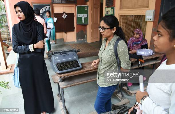 In this photograph taken on August 7 candidates wait outside the examination hall for the last official typing exam conducted by the state government...