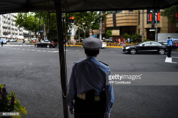In this photograph taken on August 9 2017 a Chinese traffic policeman stands guard at a road intersection in Shanghai From toiletpaper dispensers to...