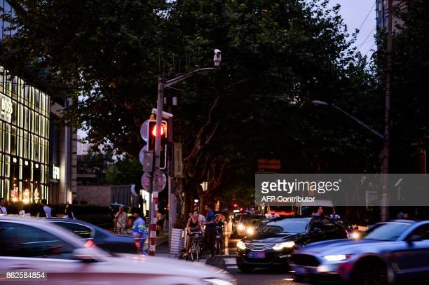 In this photograph taken on August 9 2017 a facial recognition camera is seen installed at a intersection to take pictures of people crossing roads...