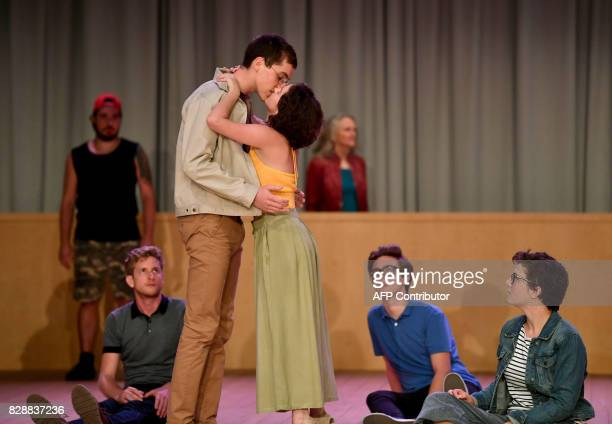 In this photograph taken on August 9 members of the cast take part in a rehearsal of Ödon von Horvath's 'Kasimir and Karoline' in Salzburg The play...