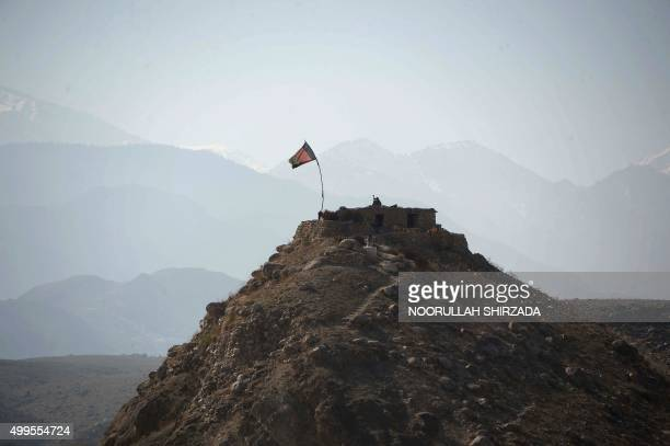 In this photograph taken on December 1 a member of the Afghan security force takes position at an outpost during an ongoing operation against Islamic...