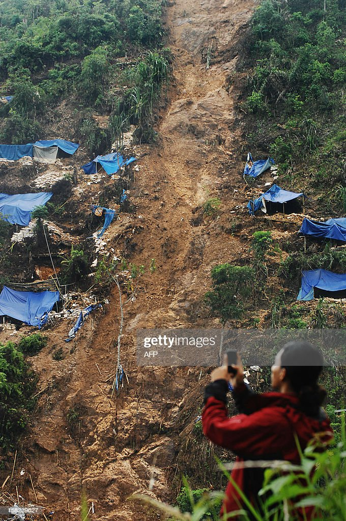 In this photograph taken on December 11, 2012, a villager view the shacks of illegal gold miners hit by a landslide in Mount Buleud in Sukabumi regency, West Java province. Authorities said at least two gold miners were killed on December 10 after the landslide following heavy rains. AFP PHOTO / WAUNTARA
