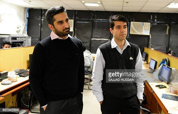 In this photograph taken on December 13 Abhishek Sharma and Tarun Wig founders of Indian IT security solutions company Innefu Labs speak during an...